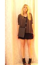black mini bubble skirt - Nine West shoes - black studded bag - green top