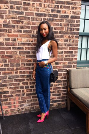 blue Dolce & Gabbana jeans - black Chanel bag