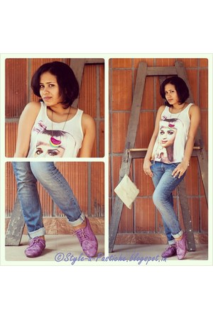 Satya Paul Sling bag - Levi Skinny Fit Denim pants - KATY PERRY vest