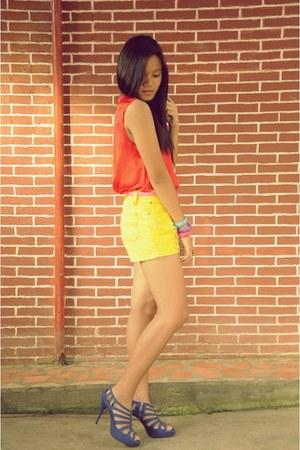 yellow Primadonna shorts - orange bare necessities top - blue Trunkshow heels