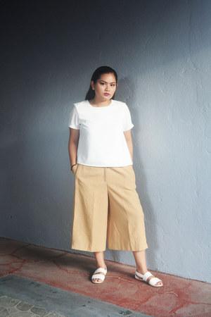 white Mango top - mustard Culottes pants - white sm parisian sandals