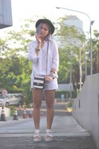 white Gaudi shirt - black hat - black sling bag Aldo bag - white Gaudi shorts