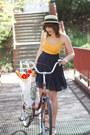 Tan-hat-navy-skirt-light-orange-top