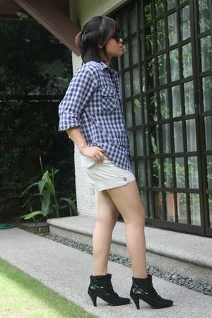 black Fiorucci shoes - blue plaidbrokeback Wrangler shirt