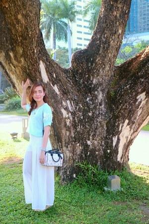 white floral coach bag - white chiffon landmark pants