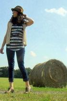 brown Target hat - silver shirt - vest - belt - jeans - shoes