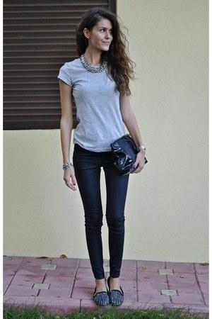 bag - grey t-shirt - black pants