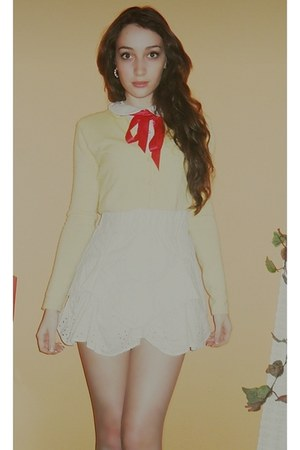red bow accessories - red bag - light yellow soft Jamie Scott cardigan