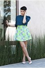 Green-worn-as-a-skirt-dress-blue-cropped-top-white-pumps-wedges