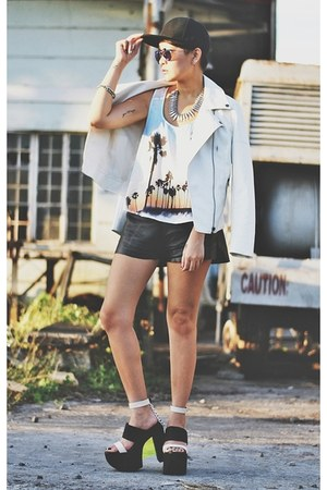 black snapback hat - ivory faux leather jacket - black faux leather shorts
