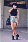 black harness boots - black studded bucket bag - blue shorts - black top