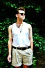 Beige-polo-shorts-white-vest-black-tooth-necklace