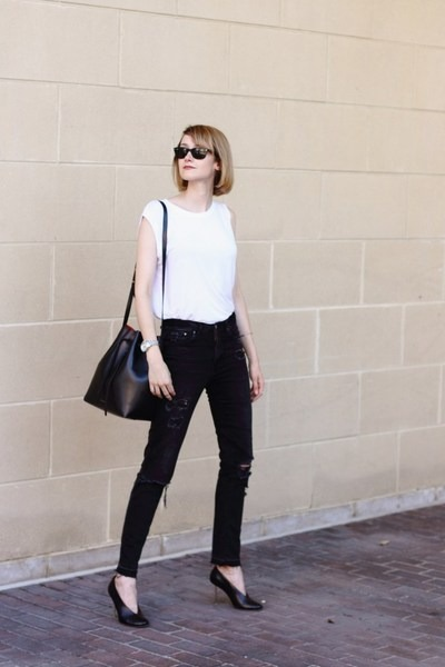 black destroyed H&M jeans - black bucket Mansur Gavriel bag