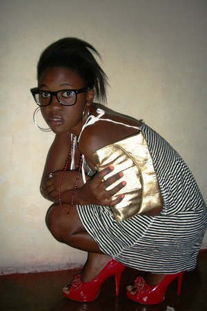 gold bag - stripped dress - geek glasses - silver earrings - red beaded necklace