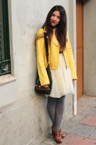 yellow leather jacket - light yellow fabric tutu dress - dark green leather bag