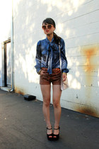blue blouse - dark brown leather shorts
