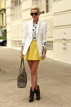 black boots - white blazer - black shirt - charcoal gray bag - yellow skirt