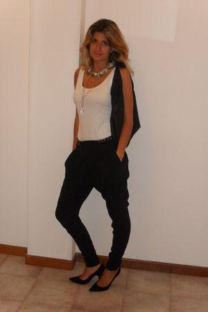 black pants - white top - black bag