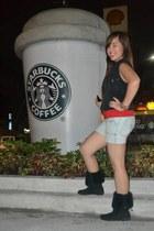 black boots - periwinkle shorts - black vest - red top