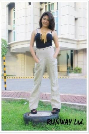 beige runway pants