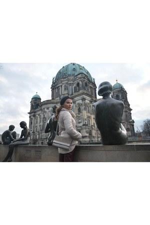 neutral leather Moschino coat - black turban Berlin Market hat