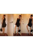 black leather Chanel purse