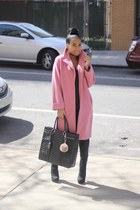 Pink coat and oversized bag