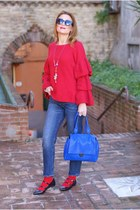 blue Zara jeans - red ruffled sleeves Northland sweater