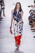 red Diane Von Furstenberg bag - white Diane Von Furstenberg pants