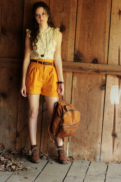 gold high waisted thrifted shorts - brown heeled Bear Traps boots