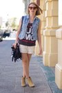 Tan-boots-black-bag-neutral-shorts-blue-vest