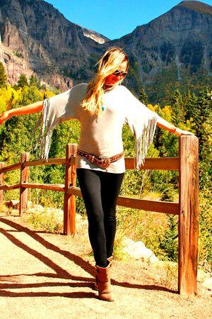 gray free people top - black pants - brown belt - brown Frye boots - gold kate s