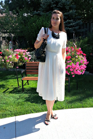white lace Dezzal dress - black leather Michael Kors bag