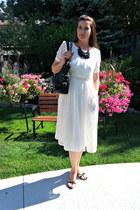 white lace Dezzal dress - black leather Michael Kors bag
