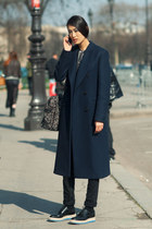 navy unknown brand coat - black Prada shoes - its printed unknown brand bag