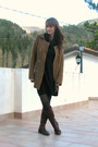 Crimson-leather-boots-dark-green-knitted-dress-gray-tights
