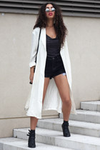 black new look boots - ivory Front Row Shop coat - black cut off vintage shorts