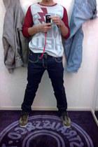 ruby red printed Friendshell t-shirt - blue slim fit Levis pants - brown adidas