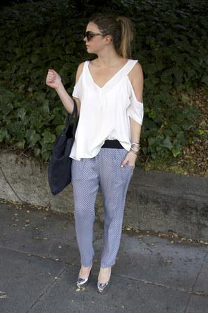 silver Giuseppe Zanotti heels - navy hlaska bag - blue Zara pants