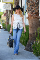 light blue flared Betsey Johnson jeans - black floppy free people hat
