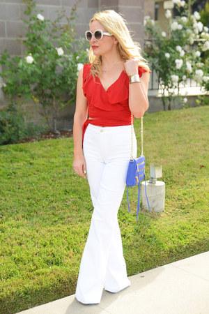 white wide leg J Brand jeans - blue cross body Rebecca Minkoff bag