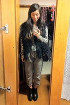 black Moschino bag - camel animal print cardigan - black vest