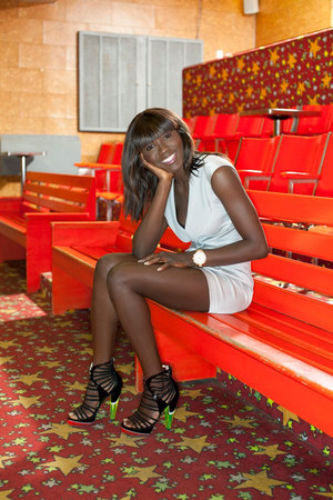 black Jimmy Choo heels - light blue Roland Mouret dress