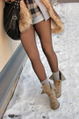 Beige-shirt-gray-blue-shorts-beige-vest-black-beige-boots
