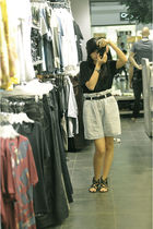 black shirt - blue shorts - black shoes