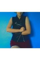 black vinyl vest