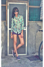 Purple-shorts-black-sunglasses-chartreuse-printed-blouse