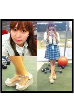 white Melissa sandals