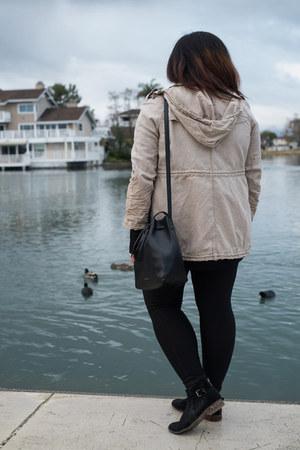 black Dolce Vita boots - beige Burberry jacket