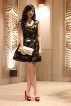 black dress - gold Louis Vuitton bag - red heels